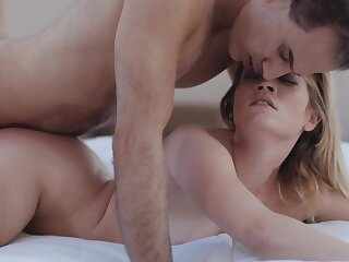 Excited guy actively drills petite blonde GF on the bed