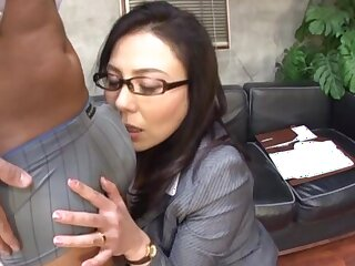 Interracial fucking with reference to the office with a Japanese secretary